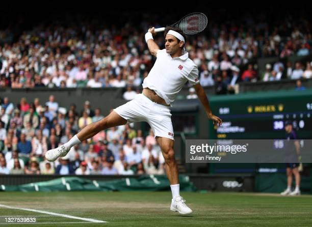 Roger Federer of Switzerland plays a backhand during his men's Singles Quarter Final match against Hubert Hurkacz of Poland on Day Nine of The...
