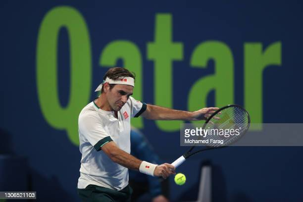 Roger Federer of Switzerland plays a backhand during his quarter final match with Nikoloz Basilashvili of Georgia in the Qatar ExxonMobil Open at...