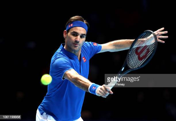 Roger Federer of Switzerland plays a backhand during his singles round robin match against Dominic Thiem of Austria during Day Three of the Nitto ATP...