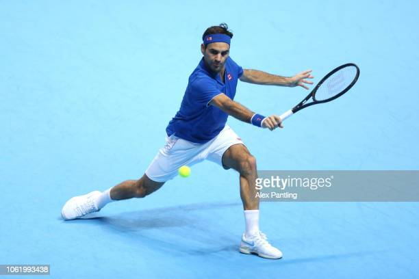 Roger Federer of Switzerland plays a backhand during his singles round robin match against Kevin Anderson of South Africa during Day Five of the...