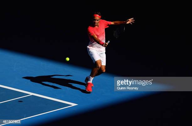 Roger Federer of Switzerland plays a backhand during practice ahead of the 2014 Australian Open at Melbourne Park on January 12 2014 in Melbourne...