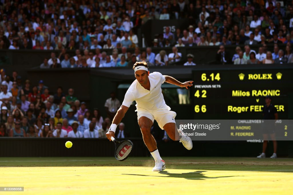 Roger Federer of Switzerland plays a backhand during the Gentlemen's Singles quarter final match against Milos Raonic of Canada on day nine of the Wimbledon Lawn Tennis Championships at the All England Lawn Tennis and Croquet Club on July 12, 2017 in London, England.