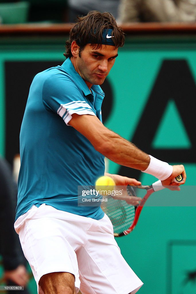 Roger Federer of Switzerland plays a backhand during the men's singles quarter final match between Robin Soderling of Sweden and Roger Federer of Switzerland at the French Open on day ten of the French Open at Roland Garros on June 1, 2010 in Paris, France.