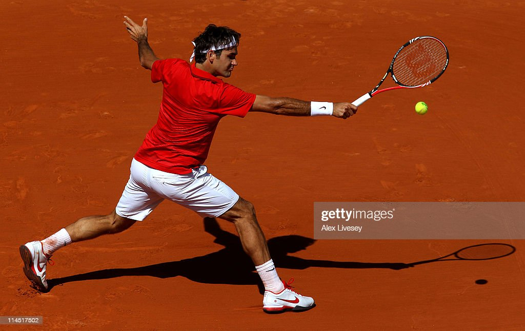 Roger Federer of Switzerland plays a backhand during the men's singles first round match between Feliciano Lopez of Spain and Roger Federer of Switzerland on day two of the French Open at Roland Garros on May 23, 2011 in Paris, France.