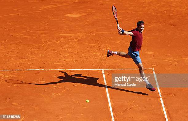 Roger Federer of Switzerland plays a backhand during the quarter final match against JoWilfried Tsonga of France on day six of the Monte Carlo Rolex...