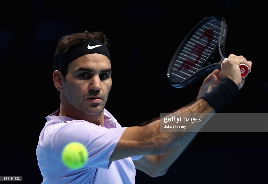 Roger Federer of Switzerland plays a backhand during the singles match against Alexander Zverev of Germany on day three of the Nitto ATP World Tour Finals at O2 Arena on November 14, 2017 in London, England.