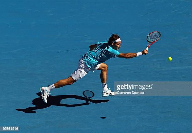 Roger Federer of Switzerland plays a backhand in his first round match against Igor Andreev of Russia during day two of the 2010 Australian Open at...