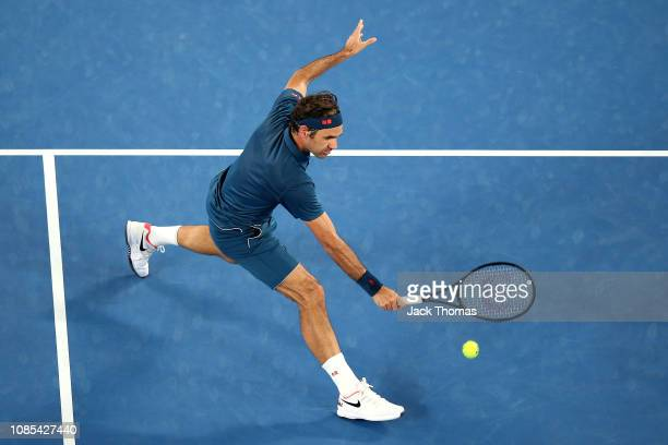 Roger Federer of Switzerland plays a backhand in his fourth round match against Stefanos Tsitsipas of Greece during day seven of the 2019 Australian...