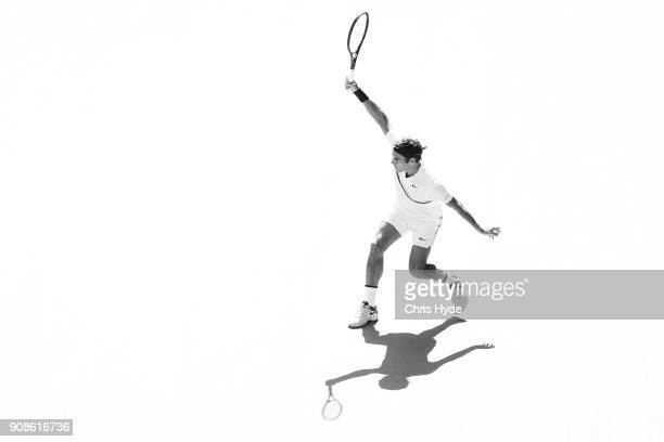 Roger Federer of Switzerland plays a backhand in his fourth round match against Marton Fucsovics of Hungary on day eight of the 2018 Australian Open...