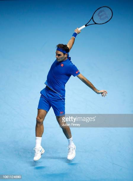 Roger Federer of Switzerland plays a backhand in his match against Kei Nishikori of Japan during Day One of the Nitto ATP Finals at The O2 Arena on...