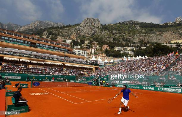 Roger Federer of Switzerland plays a backhand in his match against Philipp Kohlschreiber of Germany during Day Three of the ATP Masters Series Tennis...
