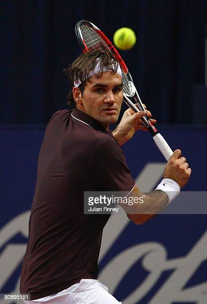 Roger Federer of Switzerland plays a backhand in his match against Novak Djokovic of Serbia in the final during Day Seven of the Davidoff Swiss...