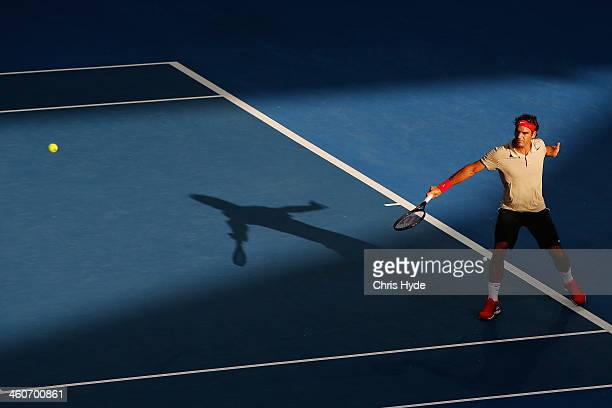 Roger Federer of Switzerland plays a backhand in his mens final match against Lleyton Hewitt of Australia during day eight of the 2014 Brisbane...