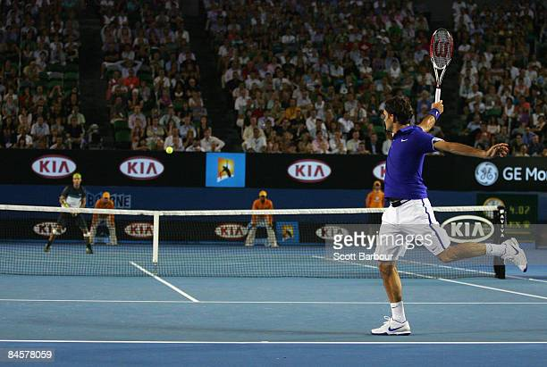Roger Federer of Switzerland plays a backhand in his men's final match against Rafael Nadal of Spain during day fourteen of the 2009 Australian Open...