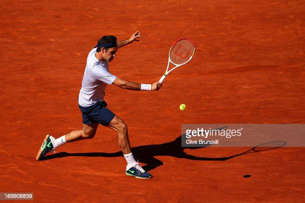 Roger Federer of Switzerland plays a backhand in his Men's Singles quarter final match against JoWilfried Tsonga of France during day ten of the...