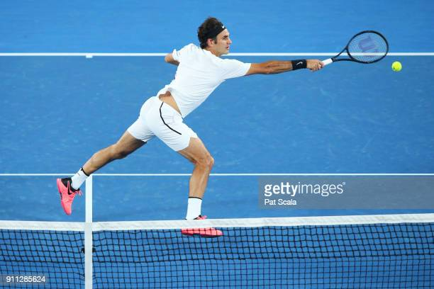 Roger Federer of Switzerland plays a backhand in his men's singles final match against Marin Cilic of Croatia on day 14 of the 2018 Australian Open...