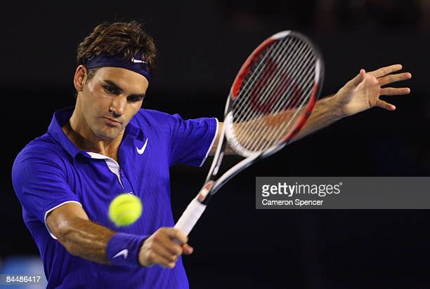 Roger Federer of Switzerland plays a backhand in his quarterfinal match against Juan Martin Del Potro of Argentina during day nine of the 2009...