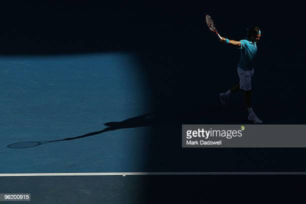 Roger Federer of Switzerland plays a backhand in his quarterfinal match against Nikolay Davydenko of Russia during day ten of the 2010 Australian...