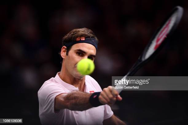 Roger Federer of Switzerland plays a backhand in his Round of 16 match against Fabio Fognini of Italy during Day 4 of the Rolex Paris Masters on...