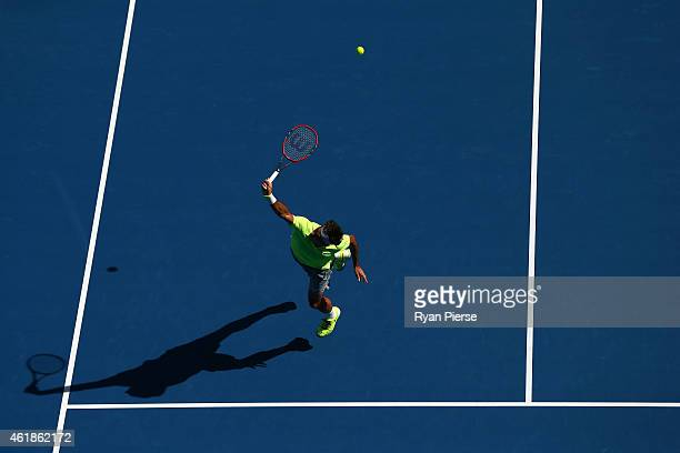 Roger Federer of Switzerland plays a backhand in his second round match against Simone Bolelli of Italy during day three of the 2015 Australian Open...