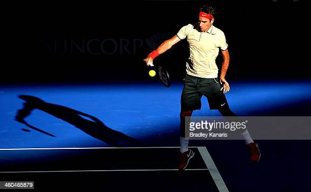 Roger Federer of Switzerland plays a backhand in his semi final match against Jeremy Chardy of France during day seven of the 2014 Brisbane...