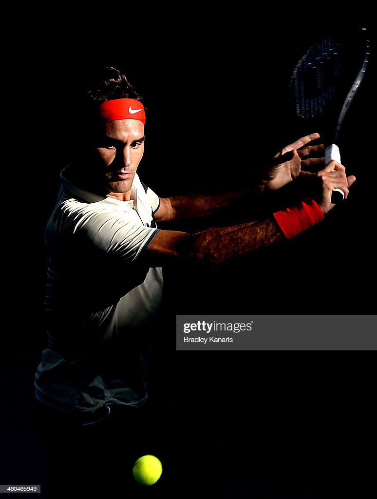 Roger Federer of Switzerland plays a backhand in his semi final match against Jeremy Chardy of France during day seven of the 2014 Brisbane International at Queensland Tennis Centre on January 4, 2014 in Brisbane, Australia.