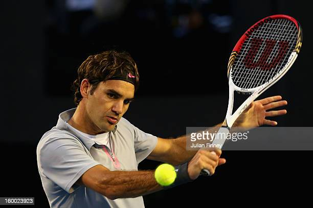 Roger Federer of Switzerland plays a backhand in his semifinal match against Andy Murray of Great Britain during day twelve of the 2013 Australian...