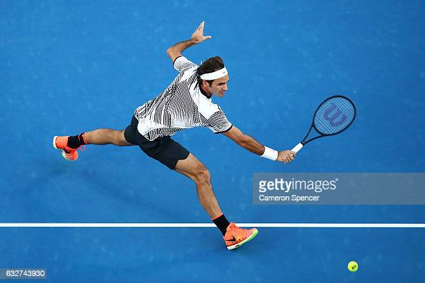 Roger Federer of Switzerland plays a backhand in his semifinal match against Stan Wawrinka of Switzerland on day 11 of the 2017 Australian Open at...