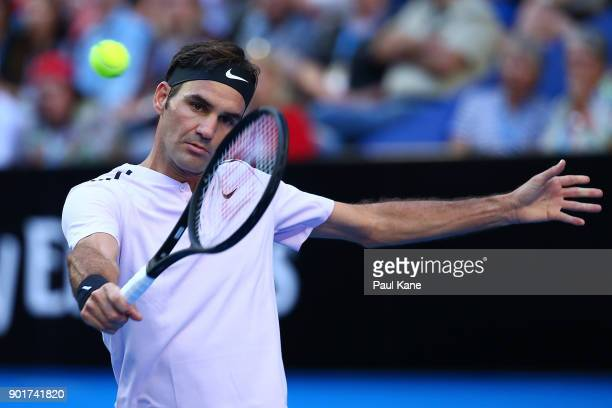 Roger Federer of Switzerland plays a backhand in his singles finals match against Alexander Zverev of Germany on day eight during the 2018 Hopman Cup...
