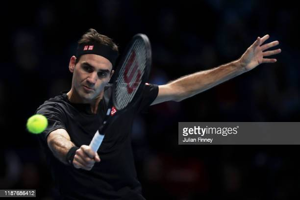 Roger Federer of Switzerland plays a backhand in his singles match against Novak Djokovic of Serbia during Day Five of the Nitto ATP Finals at The O2...
