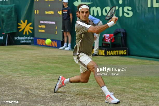 Roger Federer of Switzerland plays a backhand in the final match against David Goffin of Belgium during day 7 of the Noventi Open at Gerry Weber...
