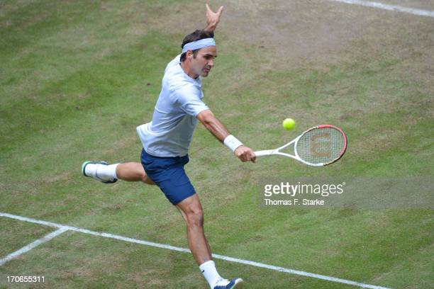 Roger Federer of Switzerland plays a backhand in the final match against Mikhail Youzhny of Russia during the final day of the Gerry Weber Open at...