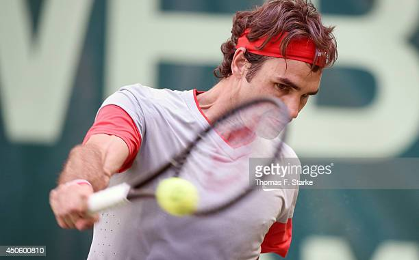 Roger Federer of Switzerland plays a backhand in the half final match against Kei Nishikori of Japan during day six of the Gerry Weber Open at Gerry...