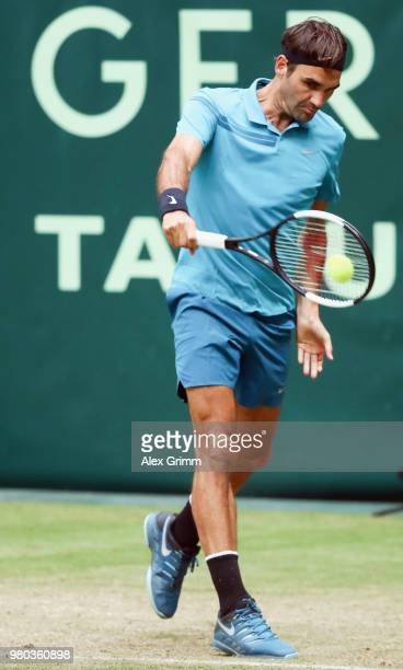 Roger Federer of Switzerland plays a backhand to Benoit Paire of France during their round of 16 match on day 4 of the Gerry Weber Open at Gerry...