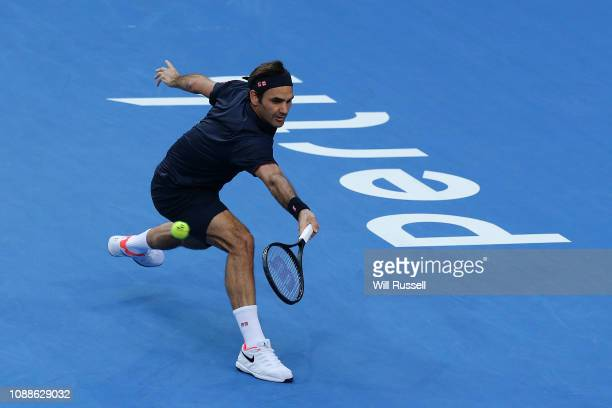 Roger Federer of Switzerland plays a backhand to Frances Tiafoe of the United States in the mens singles match during day four of the 2019 Hopman Cup...