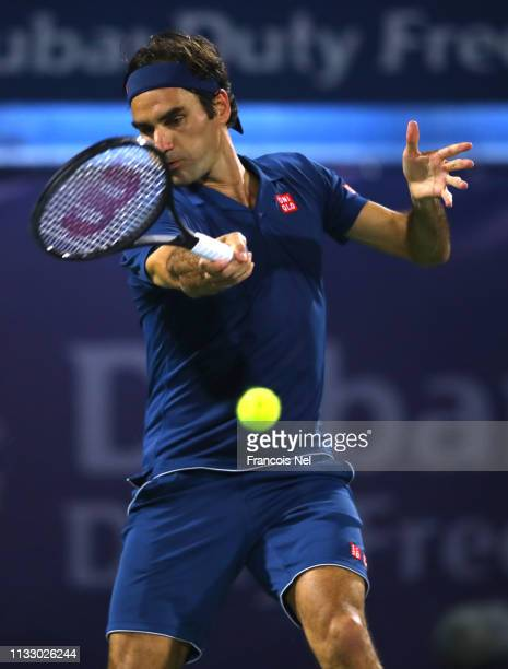 Roger Federer of Switzerland plays a forehand against Borna Coric of Croatia during in his men's semi final match on day thirteen of the Dubai Duty...