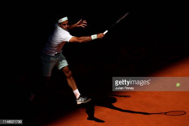 Roger Federer of Switzerland plays a forehand against Gael Monfils of France during day six of the Mutua Madrid Open at La Caja Magica on May 09 2019...