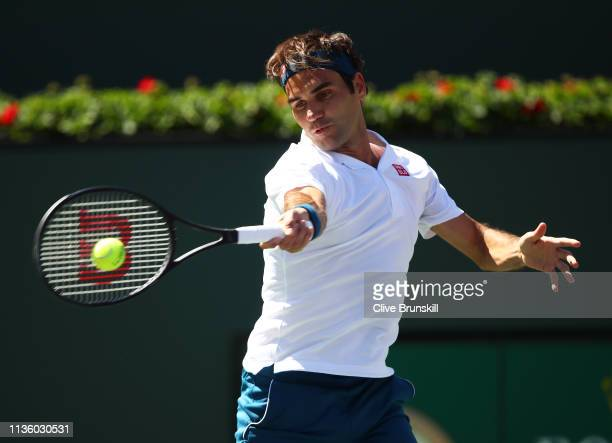 Roger Federer of Switzerland plays a forehand against Hubert Hurkacz of Poland during their men's singles quarter final match on day twelve of the...