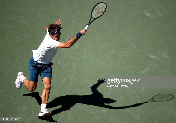 Roger Federer of Switzerland plays a forehand against Hubert Hurkacz of Poland during their men's singles quarterfinal match at the BNP Paribas Open...