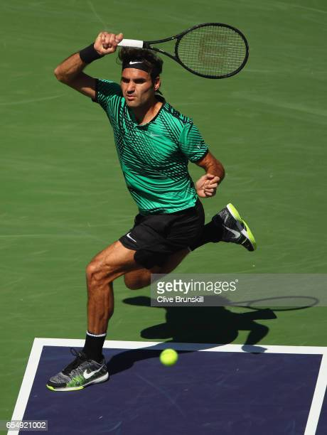 Roger Federer of Switzerland plays a forehand against Jack Sock of the United States in their semi final match during day thirteen of the BNP Paribas...