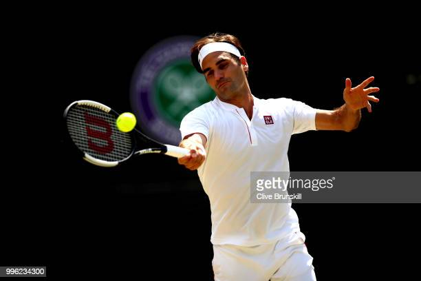 Roger Federer of Switzerland plays a forehand against Kevin Anderson of South Africa during their Men's Singles QuarterFinals match on day nine of...