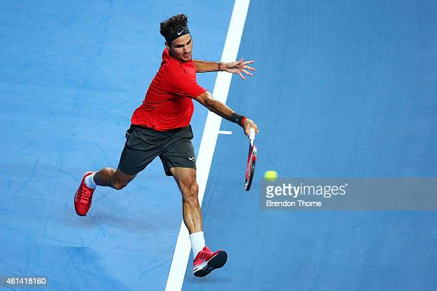 Roger Federer of Switzerland plays a forehand against Lleyton Hewitt of Australia during their match at Qantas Credit Union Arena on January 12 2015...