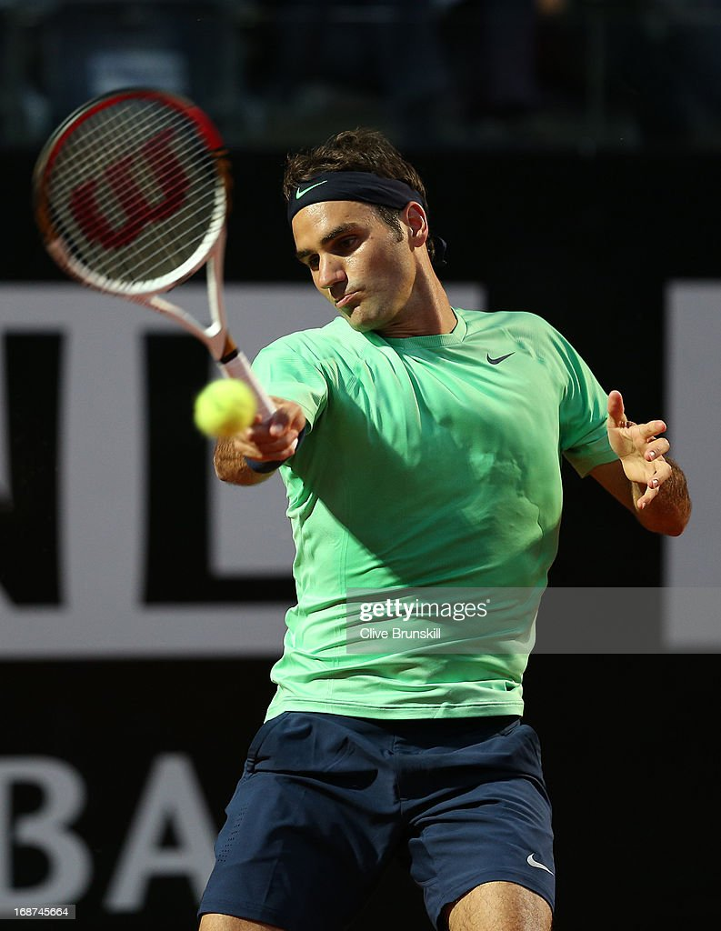 Roger Federer of Switzerland plays a forehand against Potito Starace of Italy in their second round match during day three of the Internazionali BNL d'Italia 2013 at the Foro Italico Tennis Centre on May 14, 2013 in Rome, Italy.