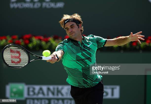 Roger Federer of Switzerland plays a forehand against Stanislas Wawrinka of Switzerland in the mens final during day fourteen of the BNP Paribas Open...