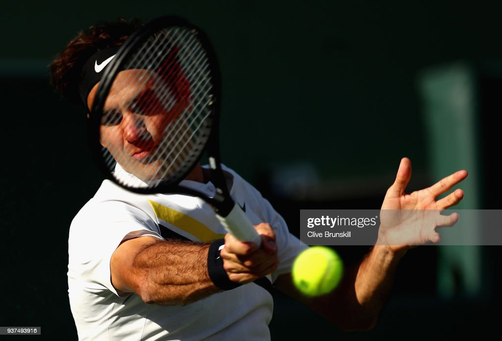 Roger Federer of Switzerland plays a forehand against Thanasi Kokkinakis of Australia in their second round match during the Miami Open Presented by Itau at Crandon Park Tennis Center on March 24, 2018 in Key Biscayne, Florida.