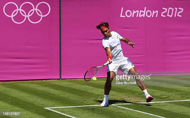 Roger Federer of Switzerland plays a forehand during a practice session during previews ahead of the 2012 London Olympic Games at at the All England...
