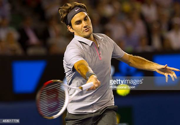Roger Federer of Switzerland plays a forehand during his fourth round match against Milos Raonic of Canada on day eight of the 2013 Australian Open...