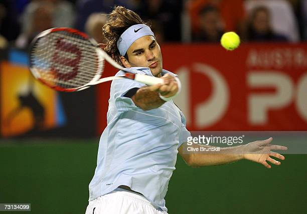 Roger Federer of Switzerland plays a forehand during his men's final match against Fernando Gonzalez of Chile on day fourteen of the Australian Open...