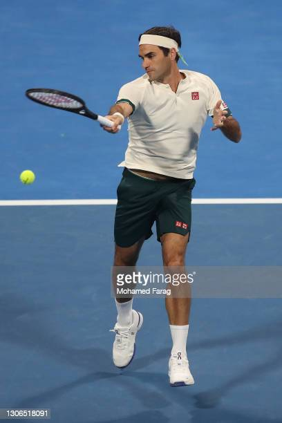 Roger Federer of Switzerland plays a forehand during his quarter final match with Nikoloz Basilashvili of Georgia in the Qatar ExxonMobil Open at...