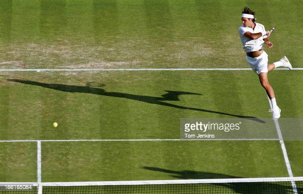 Roger Federer of Switzerland plays a forehand during his victory over Marat Safin of Russia in the men's singles tournament at Wimbledon on June 29th...